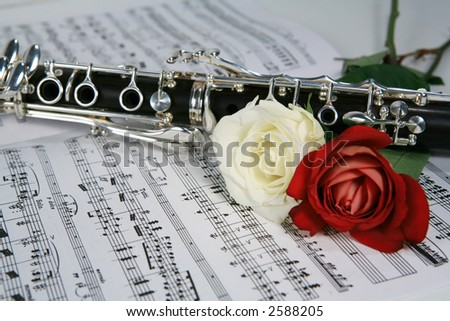 Clarinet with red and white rose on sheet music