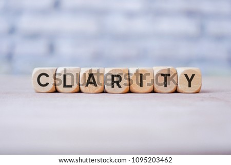 Clarity word written on wood block