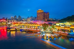Clarke Quay is a historical riverside quay in Singapore, located within the Singapore River .