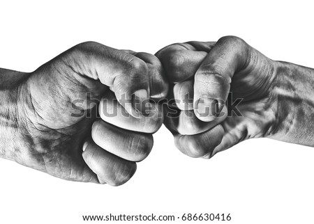 Clash of two fists on white, isolated background. Concept of confrontation, competition etc. #686630416