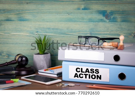 Class action. Binders on desk in the office. Business background