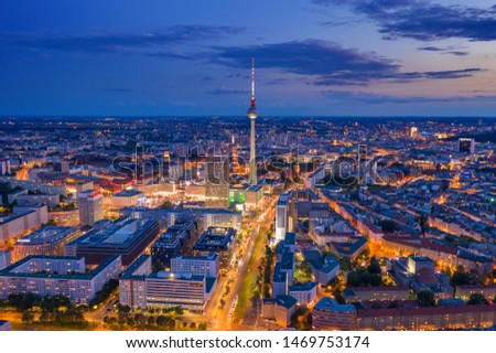 Classic aerial view of Berlin skyline with famous TV tower and Spree river in beautiful post sunset twilight during blue hour at dusk with dramatic clouds in summer, central Berlin Mitte, Germany #1469753174