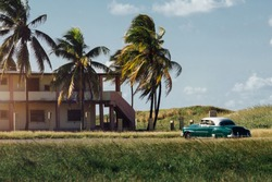 Classic american car parked house palm trees. cuba. Beautiful view, sunset. Dream Copy space.