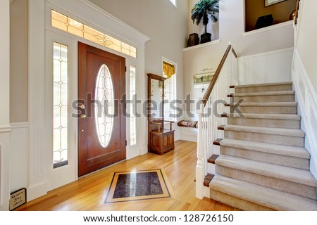 Classic AMerican home entrance interior with staircase.
