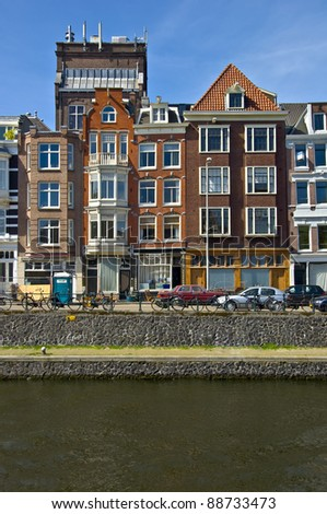 Classic amsterdam view. Residential homes on the canal. Urban scene. Spring.