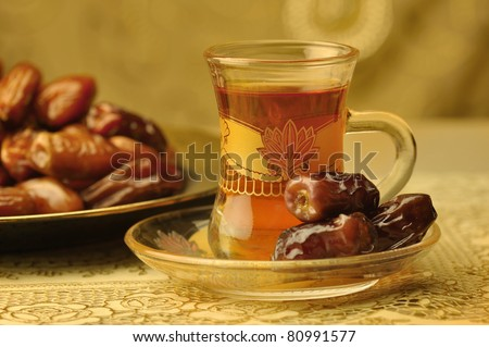 Classic arabic teacups and dates.