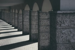 classic architecture building object of concrete pillar and arches alley way in monochrome gray colors lights and shadows style