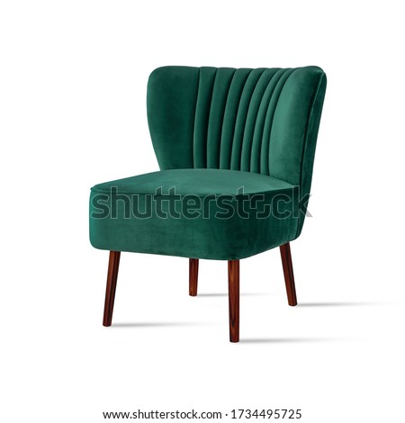 Photo of  Classic armchair art deco style in turquoise velvet with wooden legs isolated on white background. Front view, grey shadow. Series of furniture