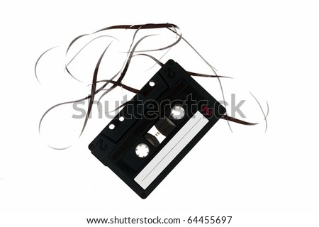 Classic audio cassette with tape isolated on white.