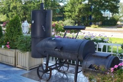 Classic Barrel Grill Appliance With Smoker On The Patio. Outdoor BBQ Grill Appliance. Barbeque Charcoal Barrel Grill On Backyard.