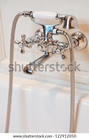 Classic bath tap in white bathroom.