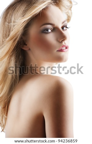 classic beauty portrait of young sexy girl with hairstyle and flying hair from wind, she is turned of three quarters at left and looks at right with mouth sligthly open