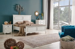 Classic bed room furniture, decorative dark blue wall background, interior room style.