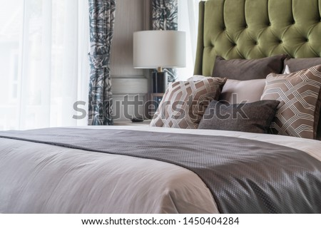 classic bedroom style with set of pillows on bed, interior design concept decoration #1450404284