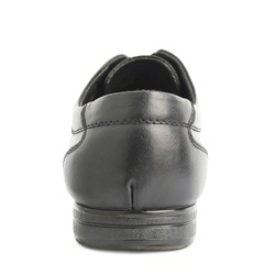 Classic black leather shoe isolated over the white background, back view