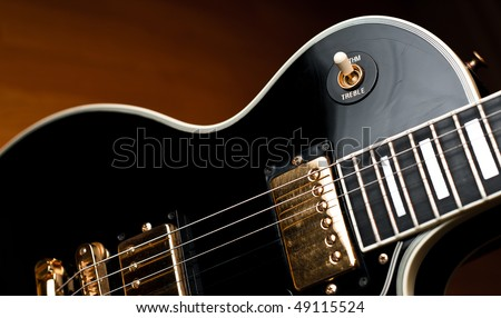 classic black les paul style rock and roll or jazz guitar in soft spotlight stage or studio. Black Bedroom Furniture Sets. Home Design Ideas