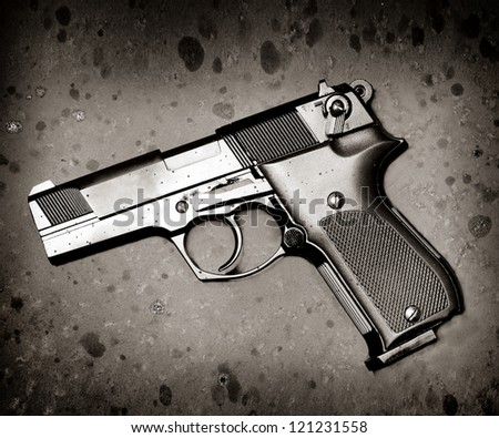 classic black pistol on rusty metal