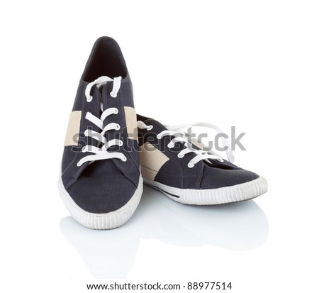 Classic black sneakers isolated on white background #88977514