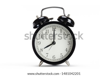 Classic black table clock isolated on a white background. Alarm clock show 8 O'Clock with copy space.