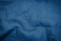 Classic blue color trend of 2021 year. Linen  cloth blue texture background. Wrinkled Linen dark blue fabric.