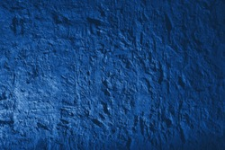 Classic blue plastered wall. Grunge texture. Art rough stylized texture banner With space for text.