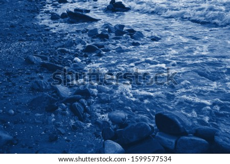 Classic blue sea beach. Monochrome classic blue sea background. Copy space. Trendy color 2020. Classic blue pool water with sun reflections. Classic blue background.