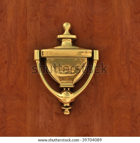 Classic brass door knocker on a wood background isolated with a clipping path