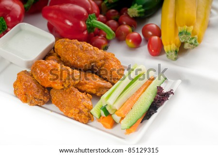 classic  buffalo chicken wings served with fresh pinzimonio and vegetables on background