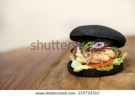 Classic Burger. Tasty and fastfood black burger meal on the table