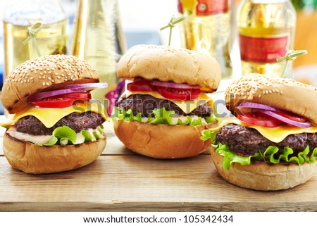 Classic Burgers with beer on background