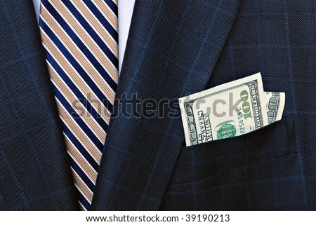 Classic business suit with silk tie and crisp 100 dollar bills in the pocket.
