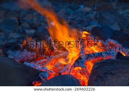 Classic camping campfire in rock fire ring at dusk closeup #269602226
