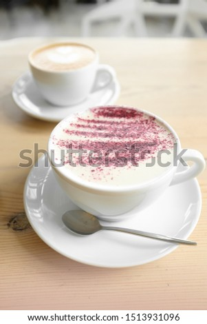 classic cappuccino and cappuccino with syrup and brightly sprinkled. coffee art heart. coffee for two. top view #1513931096