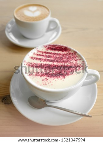classic cappuccino and cappuccino with syrup and brightly sprinkled. coffee art heart. coffee for two. top view #1521047594
