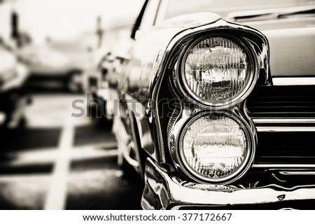 Classic car with close-up on headlights #377172667