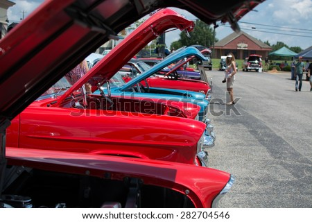 classic cars in a line at a...