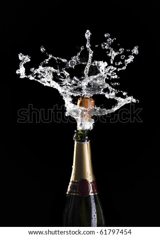 classic champagne bottle with popping cork background