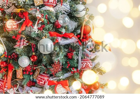 Classic Christmas New Year decorated New year tree with red and white ornament decorations toy and ball. Modern classical style interior design apartment. Christmas eve at home