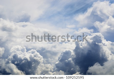 classic cloudscape. Blue sky with ornamental clouds