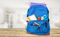 Classic colored school backpack with supplies