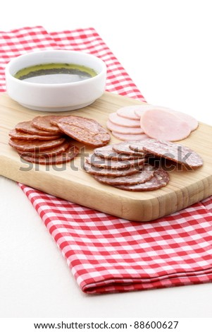 Classic delicious pizza ingredients on nice table setting or kitchen work table