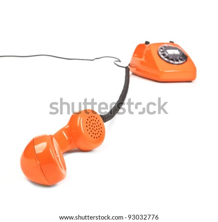 classic dial phone on white background, focus set in foreground