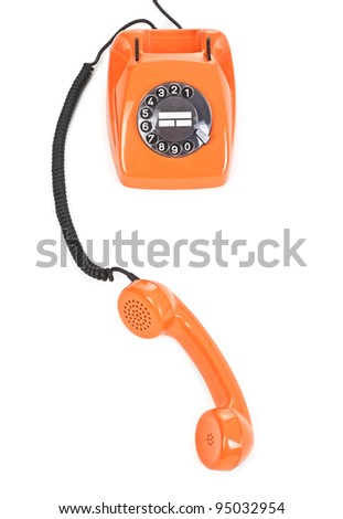 classic dial phone on white background, view from above