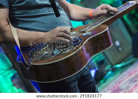 Classic Dobro guitar played my a master on concert.