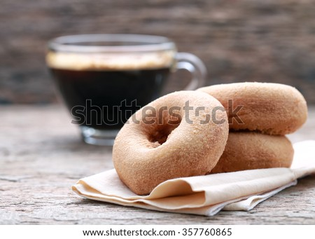 classic donut and coffee on wood background.