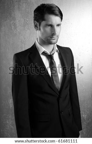 Classic elegant black and white suit handsome man portrait