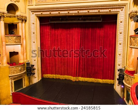 classic elegant theater stage with velvet curtains from balcony
