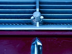 Classic Enduring Vintage Car Closeup of Windshield Water Spraying Nozzles.