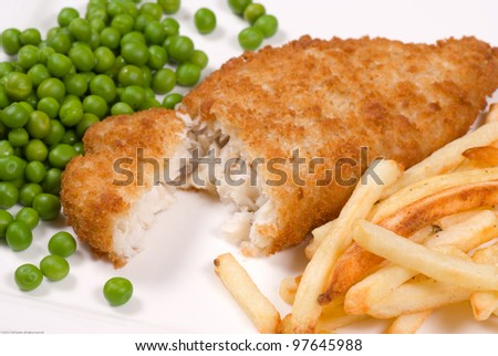 Classic English fish and chips served with peas