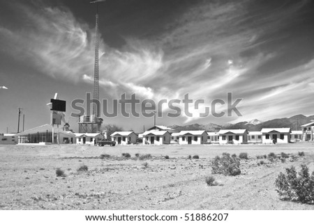 Classic Fifties Motor Hotel along old Route 66 that is now abandoned in Amboy, California - a modern ghost town in California's Mojave Desert in black and white.